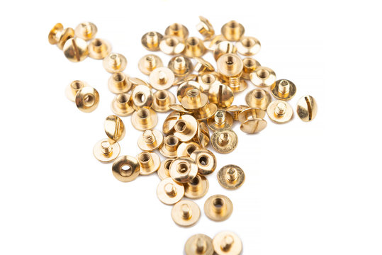 Close-up of a brass screw rivet, for electronics, construction, engineering, Golden metal on a white background.