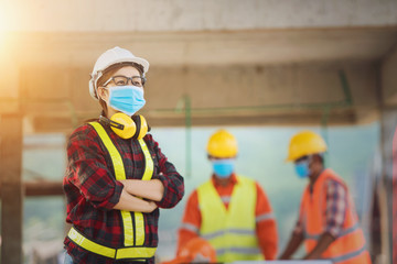 Corona or Covid-19 wear masks during the design of construction. New normal.Industrial engineering...