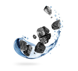 Fototapete - Pieces of coal with splashes of water on a white background