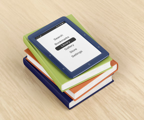 Colorful books and e-book reader on wooden table