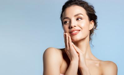 Obraz Beautiful woman hold folded palm near face  enjoying soft smooth skin. - fototapety do salonu