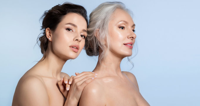 Elderly woman and young woman with perfect skin  and different age generation
