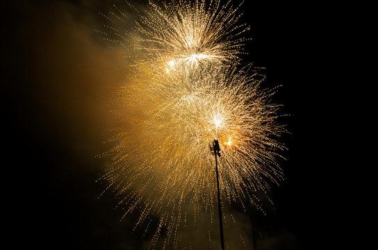 yellow fireworks against black sky