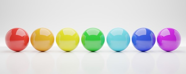 seven colorful balls or spheres on white background