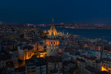 Galata Tower night aerial with Bosphorus Bridge on the background