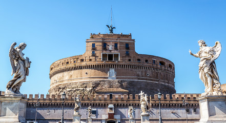 Fotomurales - Castel Sant'Angelo or Castle of Holy Angel, Rome, Italy. It is old landmark of city. Front view of famous Castel Sant`Angelo and medieval bridge