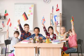 Little children during lesson at language school