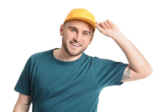 Handsome man in stylish cap on white background