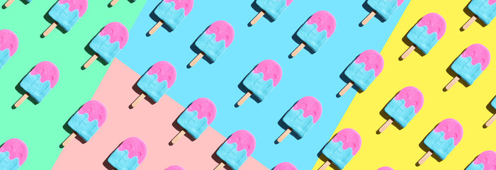 Wall Mural - Pink and blue popsicles with shadow - overhead view