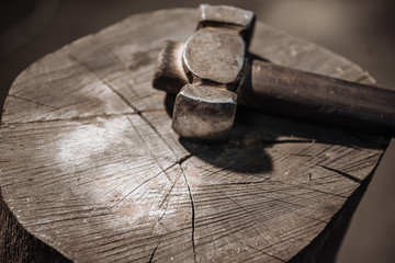 Hammer on a wooden stump.