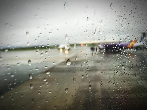 Airport Runway Seen Through Wet Glass Window