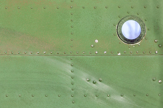 Old aircraft green painted aluminum texture with rivets.