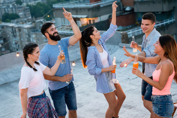 Having a great time with friends, having fun at rooftop party