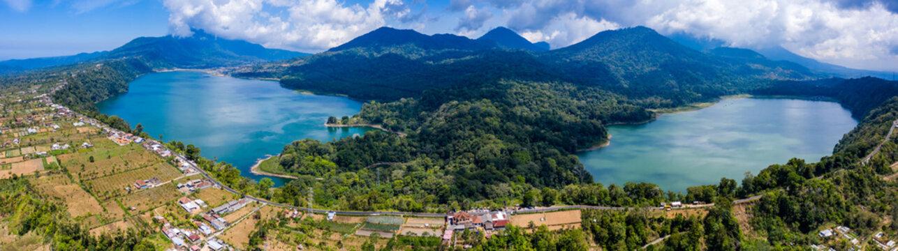 Panoramic aerial view of beautiful twin lakes in an ancient volcanic caldera (Lakes Buyan and Tamblingan, Bali, Indonesia)