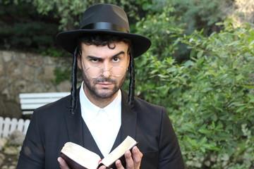 Skeptical Jewish man raising eyebrow