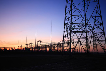 high voltage pylons in the evening