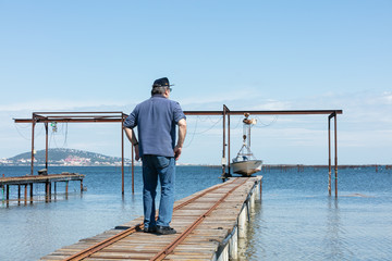 fisherman on a pontoon that goes to work