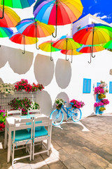 Charming bar decoration design in retro style with old bicycle,umbrellas and flowers