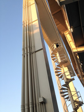 Steel tower structure at baseball stadium, scoreboard for Los Angeles Dodgers on blue sky