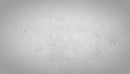 Light gray stone wall with crack in the middle. Concrete wall background texture.