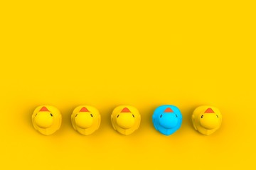 Close up of baby rubber ducks isolated. Bath toys on a yellow background. Top view with copy space. Summer wallpaper. 3d rendering.