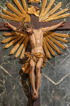 RAVENNA, ITALY - JANUARY 27, 2020: The the carved statue of Jesus on the cross in baroque church Chiesa di Santa Maria del Suffragio by D. Toschini (1752).