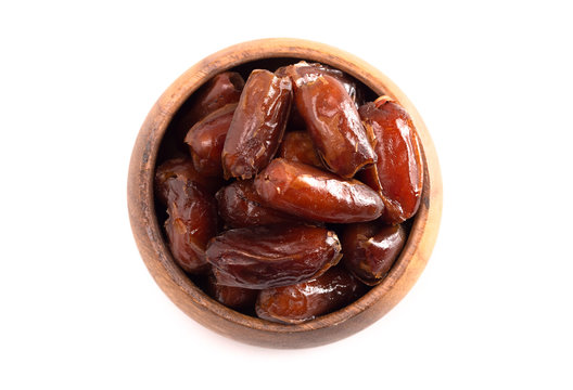 Bowl of Pitted Dates Isolated on a White Background