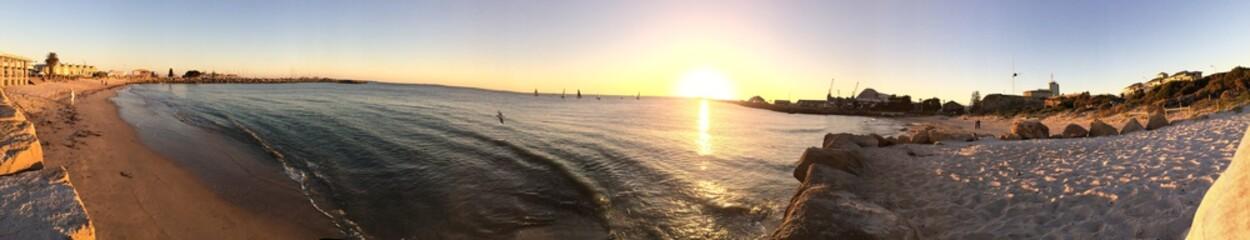 Panoramic Shot Of Calm Beach At Sunset