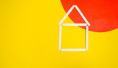 Wall Mural - .A wooden house on a yellow floor