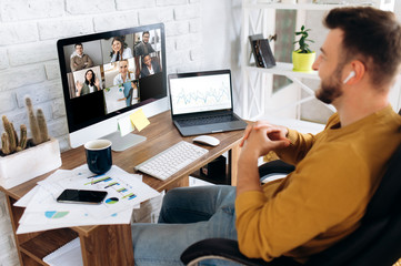 Communication by video conference. Close up photo of computer screen with people. Business colleagues discuss about economic trends by video conference from home. Distant work