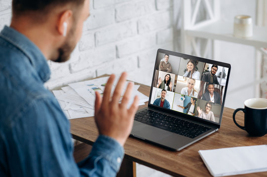 Video conference. Business partners communicate via video conference using laptop. The guy talks with his business partners appearance about plans and strategy. Distant work