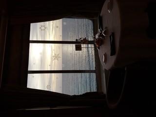 Tuinposter Muziek Sea Against Sky Seen Through Window Of Cruise Ship