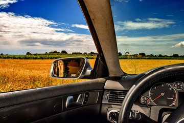 Foto auf AluDibond Grau Verkehrs Car Rear View Mirror Against Countryside Landscape