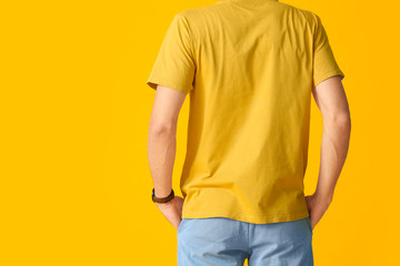 Man in stylish t-shirt on color background
