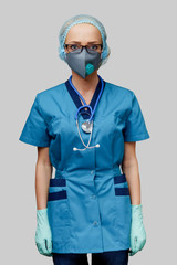 female doctor with stethoscope wearing protective mask and latex gloves over light grey background