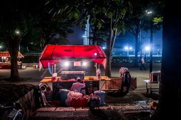 Illuminated Food Stall At Street
