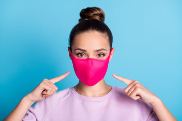 Photo of attractive lady keep social distance ignoring people contacting use respirator direct fingers safe face wear protect facial mask stylish sweater isolated blue color background