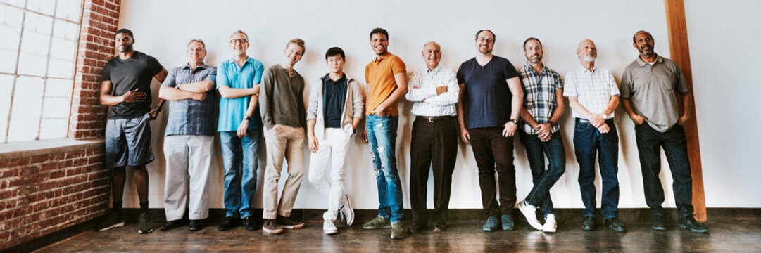 Cheerful diverse men standing in a row
