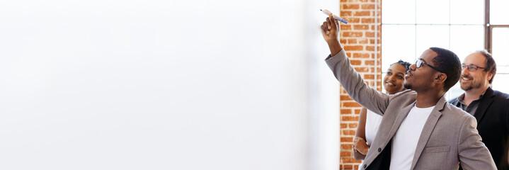 Businessman writing on a whiteboard