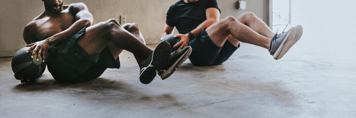 Sportive men working out with fitness balls