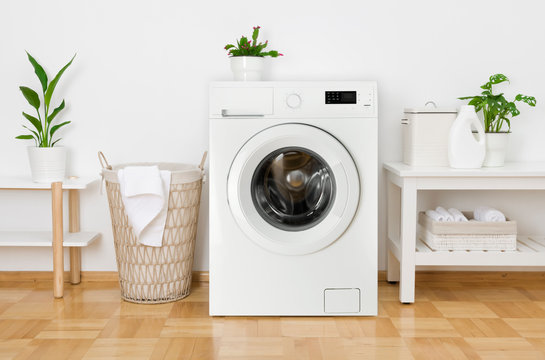 Rustic interior of home laundry room with modern washing machine