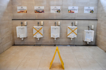 Urinals are seen at a toilet in the rest area of toll road amid the coronavirus disease (COVID-19) outbreak