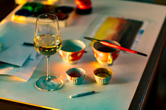 glass of wine on the artists work table