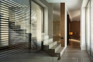 Glass wall in home corridor