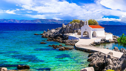 Authentic traditional Greek islands- unspoiled Chios, View of little church in the sea over the rocks , Agios Isidoros
