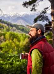 Tourist with coffee in the woods