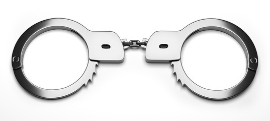 Real metal handcuffs. Closed police handcuffs close-up on a white background.