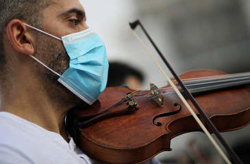 Musicians perform during a protest in demand of state aid to mitigate financial losses of artists due to the coronavirus disease (COVID-19) outbreak, in Athens