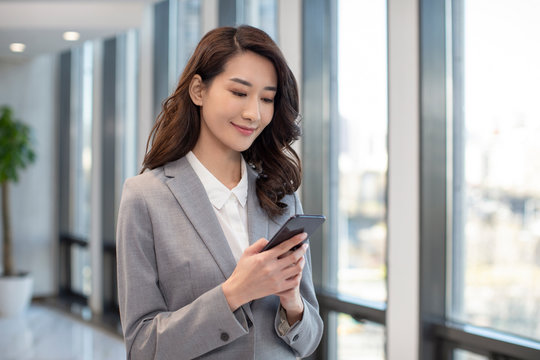 Young businesswoman using smartphone