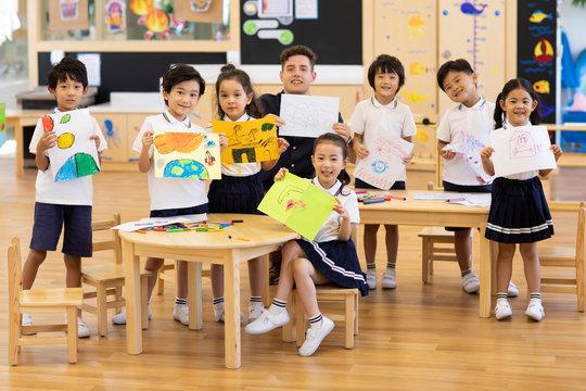 Children having art class in classroom